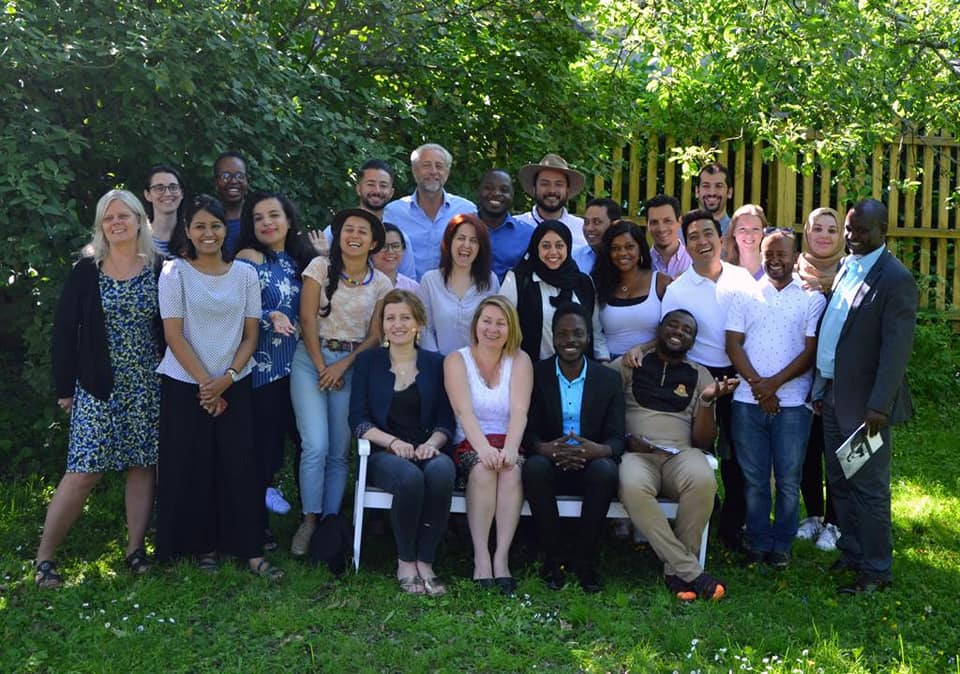 A group photograph from the International Training in Dialogue and Mediation programme in 2019.